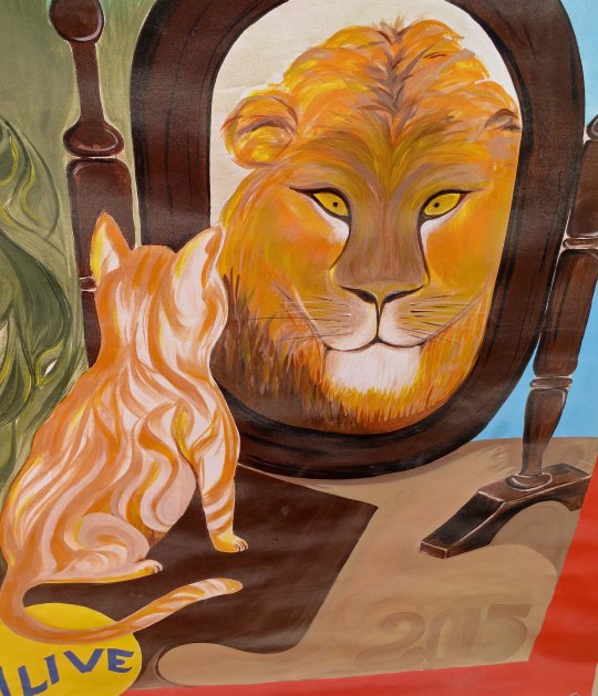 Mirror, mirror on the wall, who is the most ferocious beast of all? Cat dreams. I thought this carnival poster at Burning Man 2015 was particularly relevant to the theme.