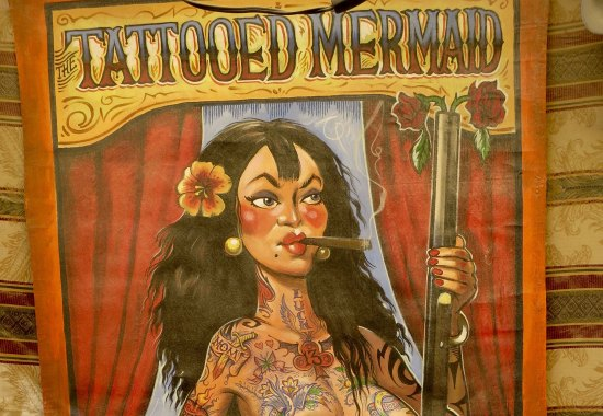 While I am dealing with mermaids, this cigar chomping cutie represents the fact that tattoo covered people became a part of the sideshow business in the 1950s. Check out my blog on the Triangle Tattoo Museum if you haven't already seen it.