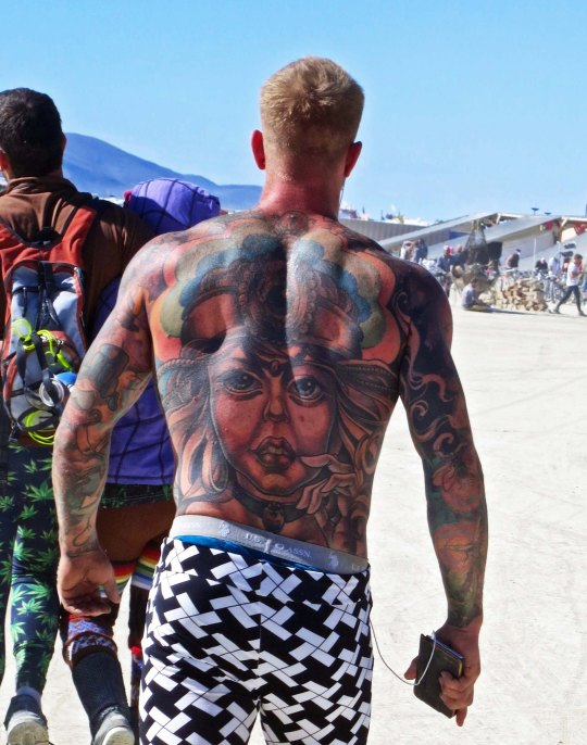 As you might imagine, there are lots of tattoos on display at Burning Man. I was particularly impressed with this guys art.