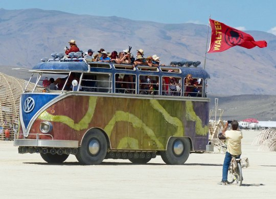 Walter the Bus zips across the Playa at 5 MPH.