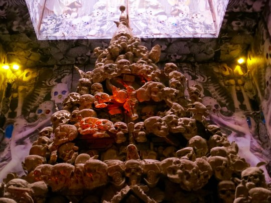 The confessional booth inside the temple included this tower of skulls. Strange, yes, but I once visited a church in Evora, Portugal whose walls and ceilings were made of skulls, real ones.