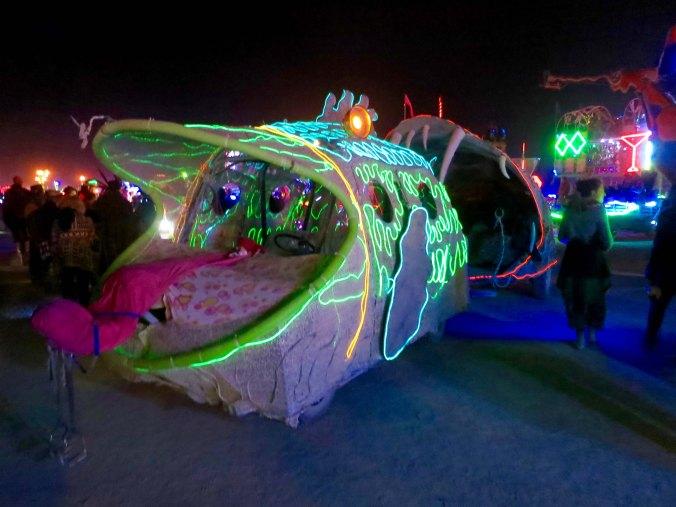 13 Fish eating fish at night mutant vehicle at Burning Man