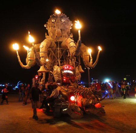 Here's a view of the giant octopus, El Pulpo Mechanico, at night, with flames coming out of his tentacles and his head. El Pulpo transported Sarandon around Burning Man when she first visited Black Rock City in 2013.