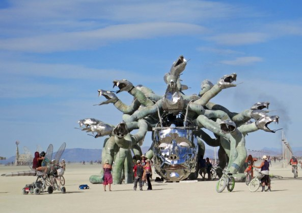 20 People admiring Medusa at Burning Man 2015