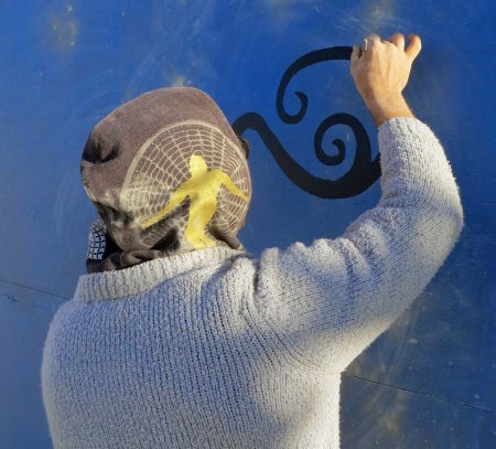 Arriving early at Burning Man in 2015, I was able to watch a number of mural artists at work.