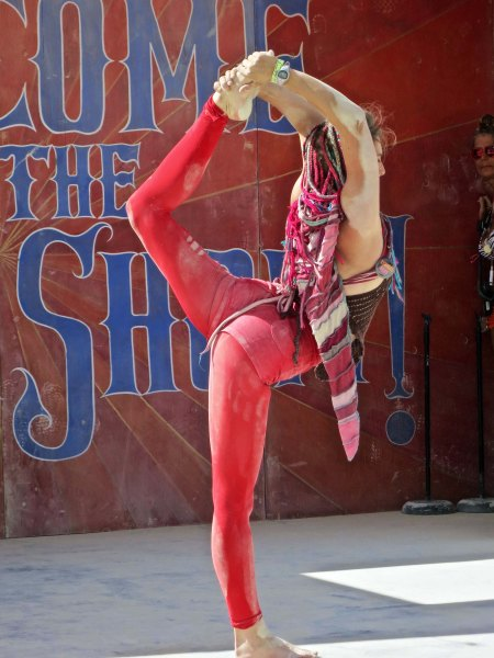 A stage in the carnival featured ongoing shows such as this flexible acrobat.