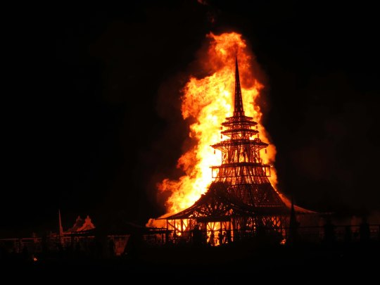 The temple of Juno from 2012 burns, shooting flames high into the sky.