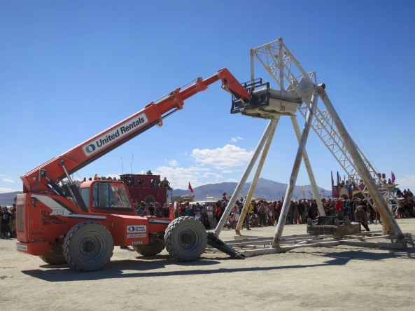 This is another way the equipment was used. The large block is being raised into the air to toss a burning piano that is affixed to the other end of the tower.