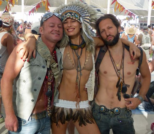 Burning Man has a rule about not wearing feathers. They tend to escape onto the Playa and have to be cleaned up. That never stops people from wearing feathers. I thought they looked good on this woman. (Photo by Don Green.)