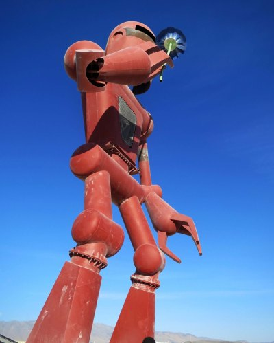 2015 Burning Man robot sniffs flower