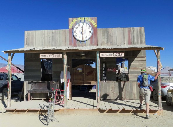 Camps at Burning Man have mastered the false fronts of the Old West. Free drinks were offered here at night, as they are by numerous camps.