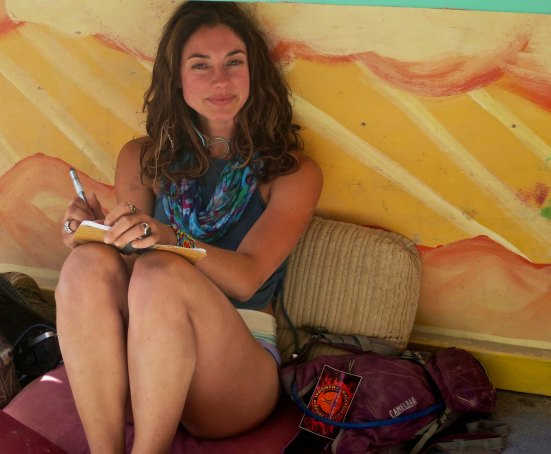 I identified with this woman as she sat alone and worked on her journal, capturing her experience at Burning Man. It could have easily been me.