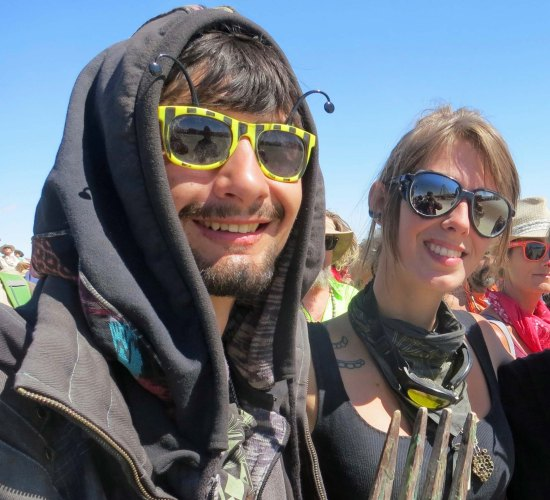 This young couple stood next to me as we watched a burning piano be tossed 50 or so yards up the Playa. Glasses form an important part of Burner's costumes.
