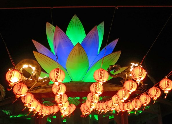 A view of the Mazu Temple at night displaying its lantern and lotus.