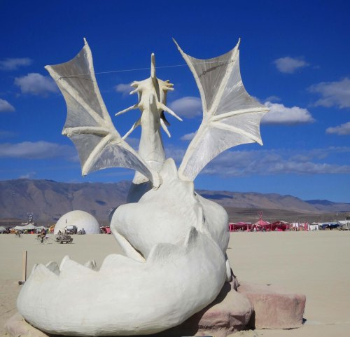 Rear view of White dragon sculpture at Burning Man
