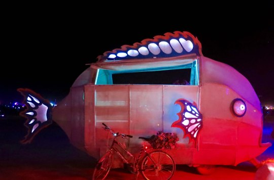 Fish mutant vehicles at night Burning Man 2015