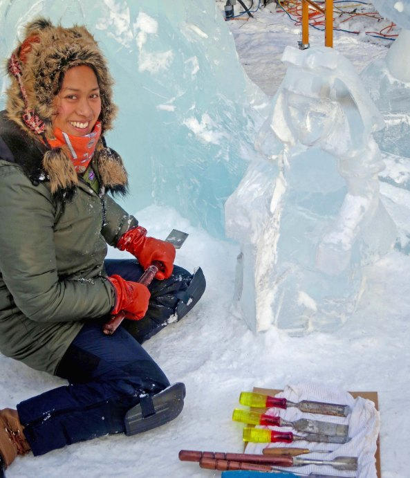 """Anne Marie Tabardo takes a break from carving """"Alice"""" at the 2016 World Ice Art Championships in Fairbanks."""