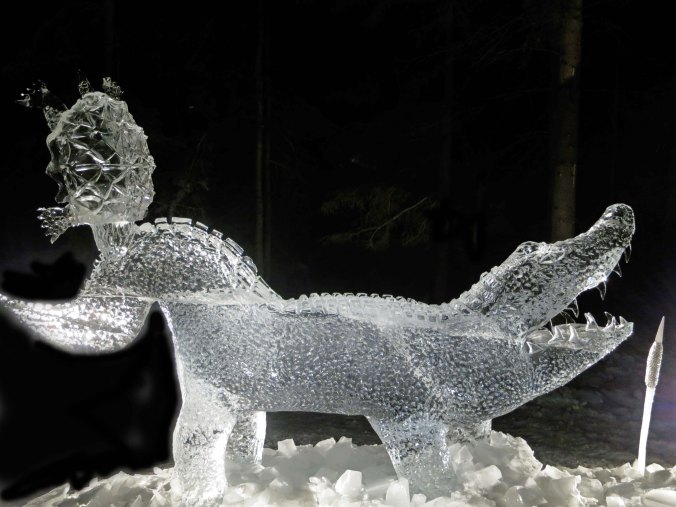 """""""Snapped"""" ice carving sculpture at night at the 2016 World Ice Art Championships in Fairbanks, Alaska"""