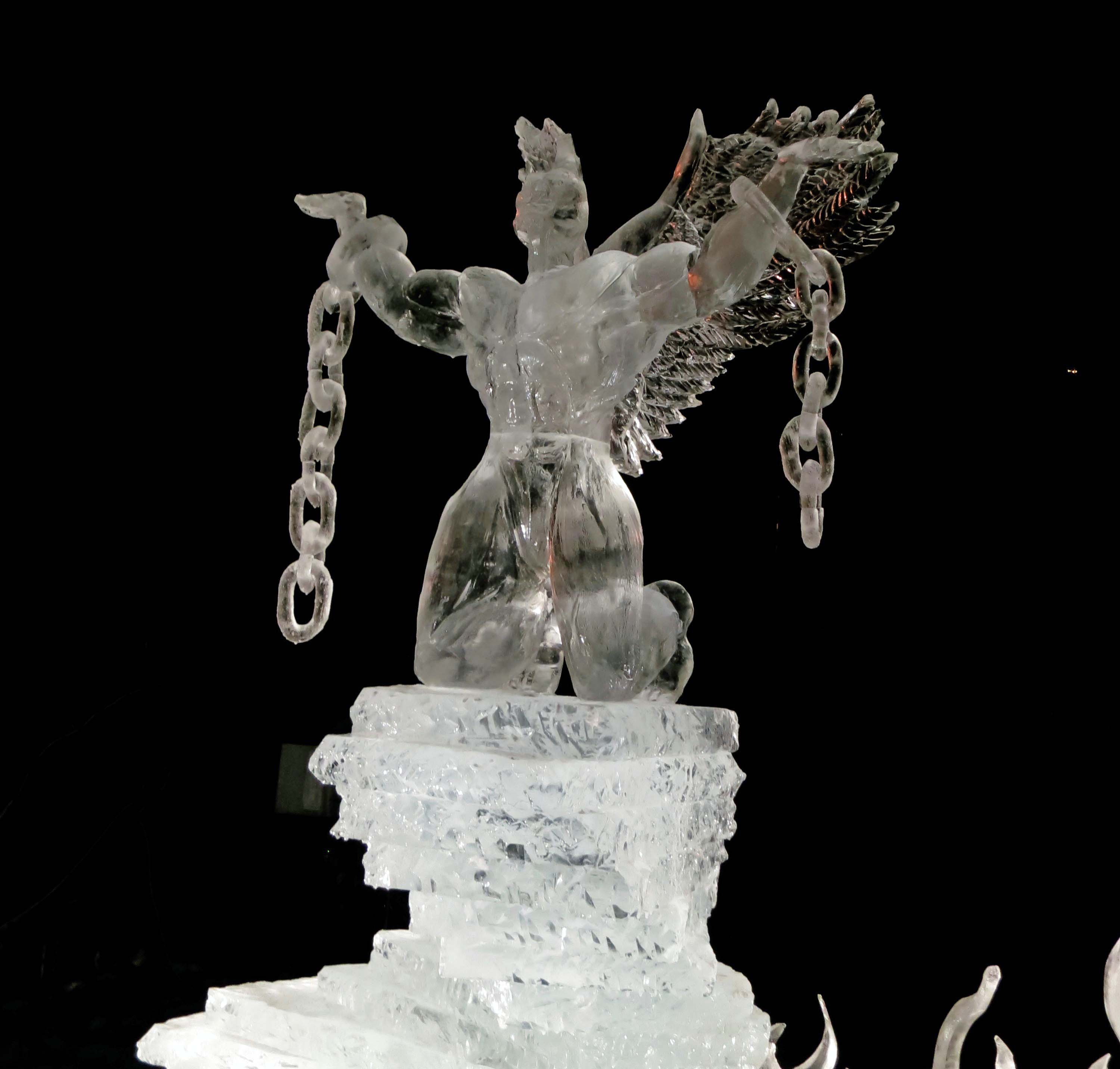 """Night photo of sculpture """"Still I Rise"""" at the 2016 Word Ice Art Championships in Fairbanks."""