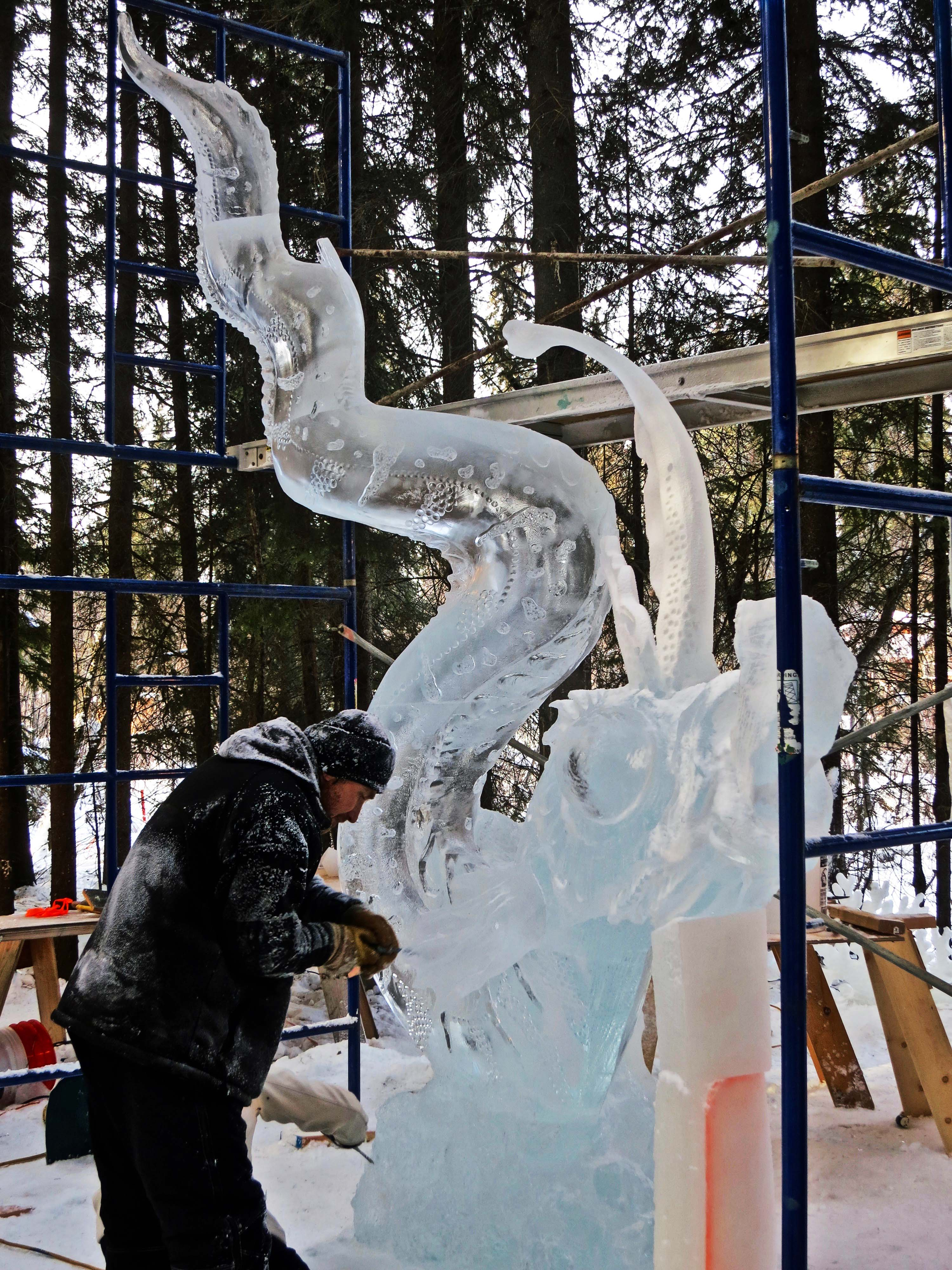 """The """"Jellyfish Hunter"""" is carved at the 2016 Word Ice Art Championships in Fairbanks."""