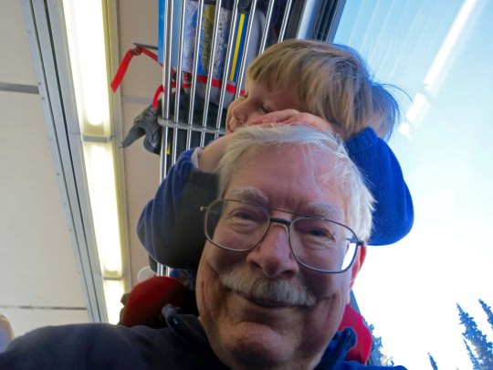Our son Tony and his family talked us into the railroad trip and other great adventures we had on this visit to Alaska. We owe the family big. In this photo, Tony and Cammie's son Cooper has decided my head is a good place for a snooze. (I took this as a selfie.)