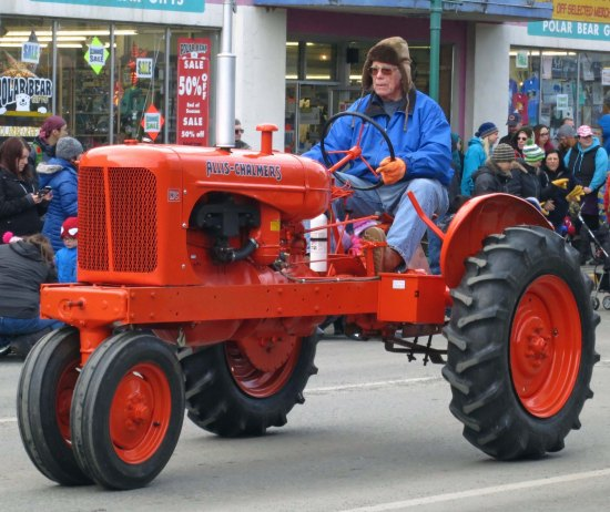 Old tractor featured in 2016 Fur Rondy Parade in Anchorage, AK.