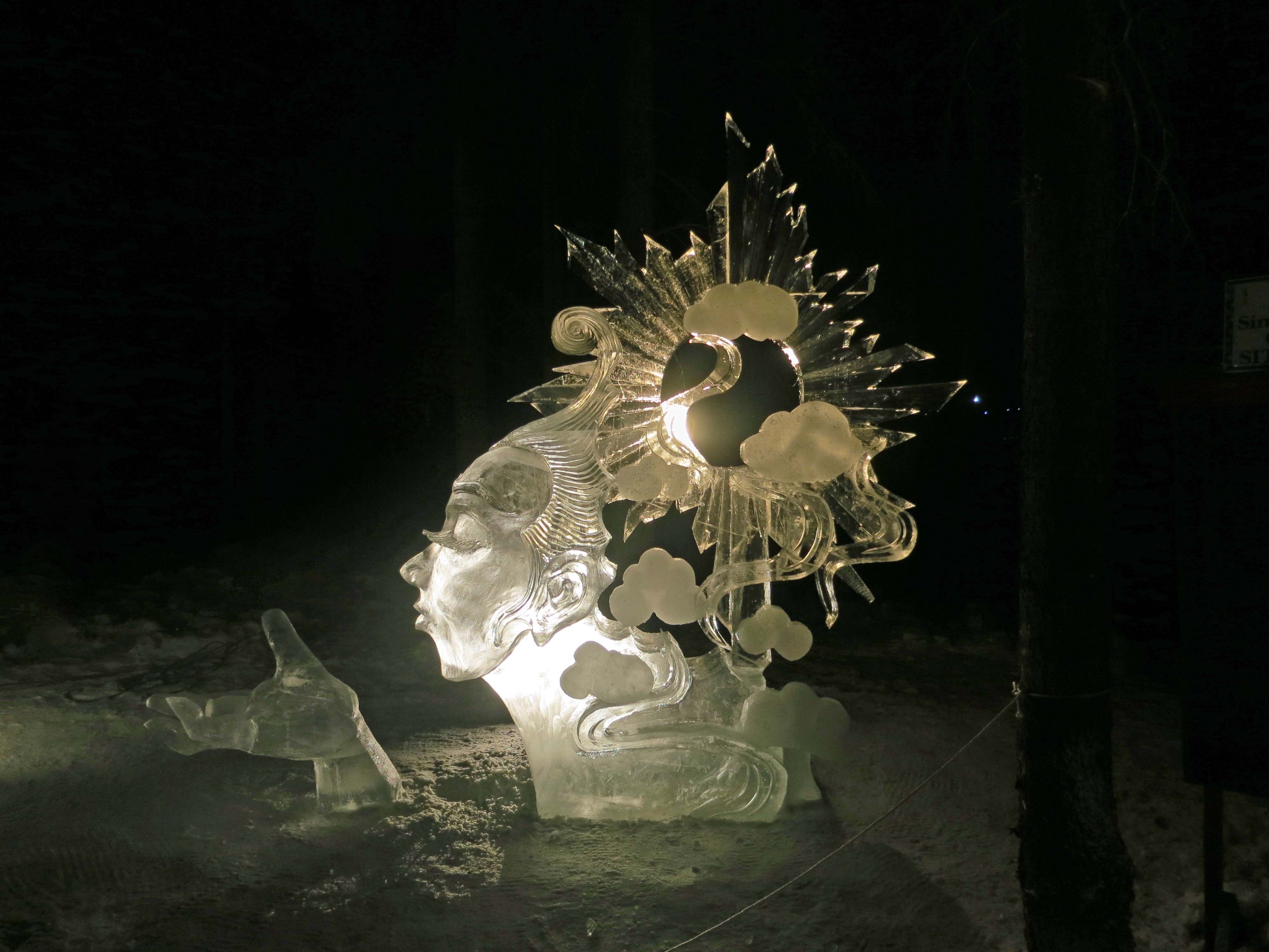 """""""The North Wind and Sun"""" sculpture at the 2016 Word Ice Art Championships in Fairbanks."""