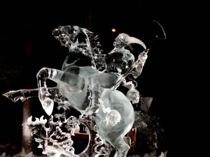 """Ice art sculpture """"Soul Collector"""" lit up at night at the 2016 International Ice Art Competition in Fairbanks, Alaska."""