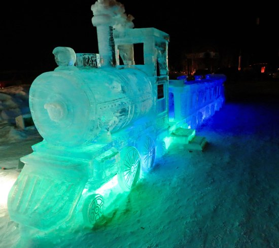 Ice sculptures, such as this train carved out of ice, are lit up at night at the Fairbanks Ice Park.