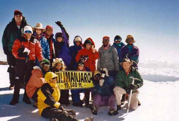 Bone celebrates on top of Mt. Kilimanjaro!