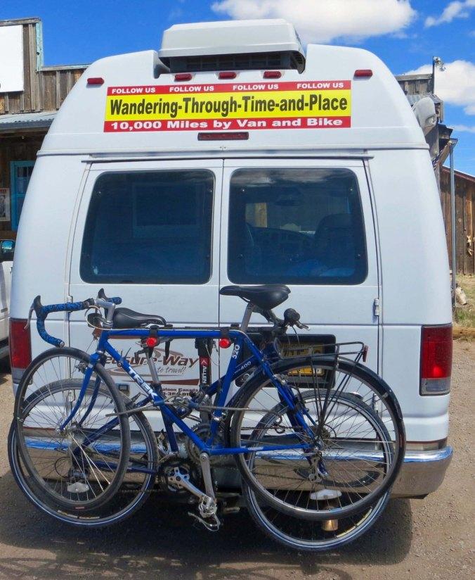Quivera, the Van. We put a sing on Quivera to encourage people to follow my blog. The blue bike on the outside is the bike I rode around North America.