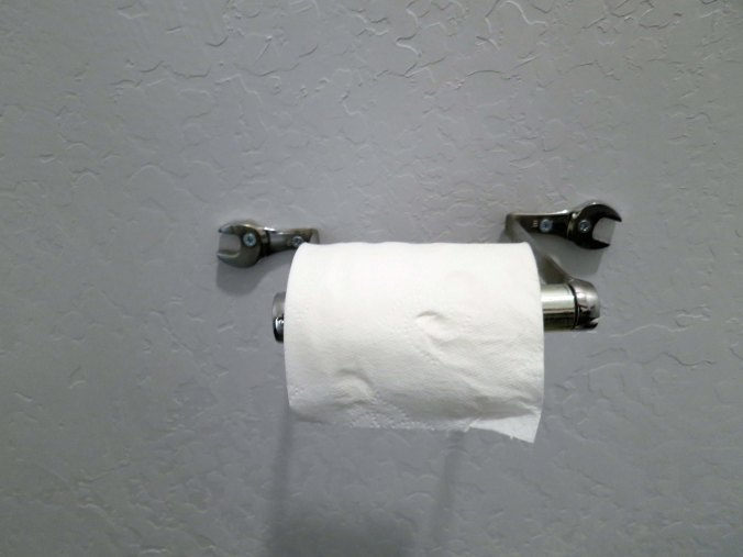 Even the toilet paper dispenser followed the theme.