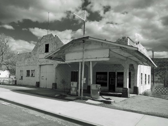 An old building that served as a gas station and garage during the heyday of Route 66. The gas pumps had been updated, but even they were no longer in use. I rendered the photo in black and white to represent the era.
