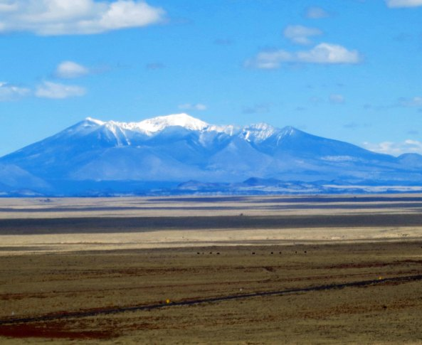 Another view of the San Francisco Mountains— this time from the east. Flagstaff nestles at their base.