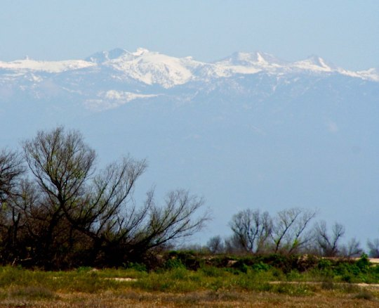 The Sierra Nevada Mountains as seen from a road leading into Porterville, California.