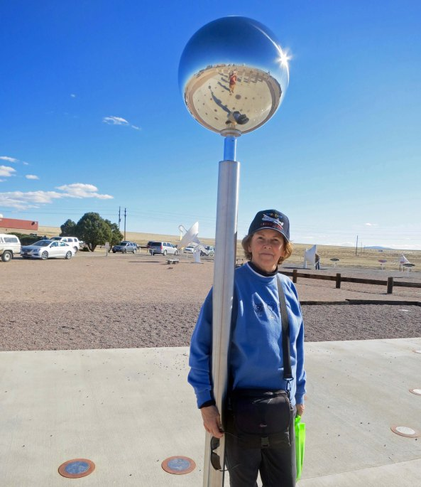 "Peggy snuggles up to a sundial at the VLA, counting down the hours until she can watch ""Independence Day"" again."