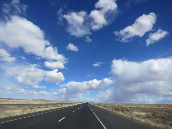 Wide open country, fluffy clouds, a broad shoulder— and for the moment, no vehicles.