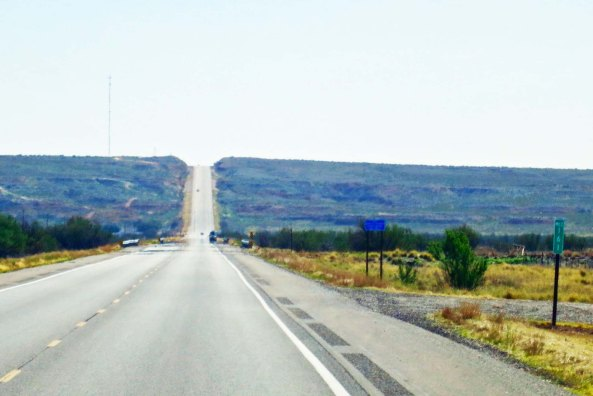 My roads in the west were always disappearing over the horizon. This is New Mexico 380 dropping down into the Pecos river and climbing out the other side.