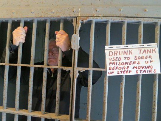 The jail, in itself is worthy of stopping off at the museum. Here I am locked up in the drunk tank.