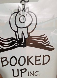 Booked Up store window sign in Archer City, Texas.