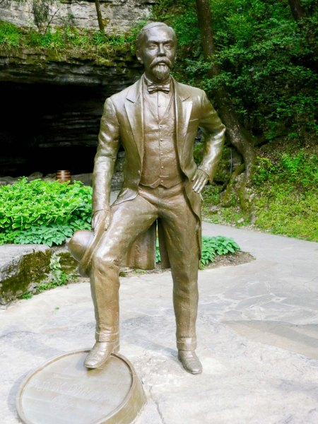 A sculpture of Jack Daniels with his foot resting on a barrel. The state was located on a rock. It's title was Jack Daniels on the Rocks.