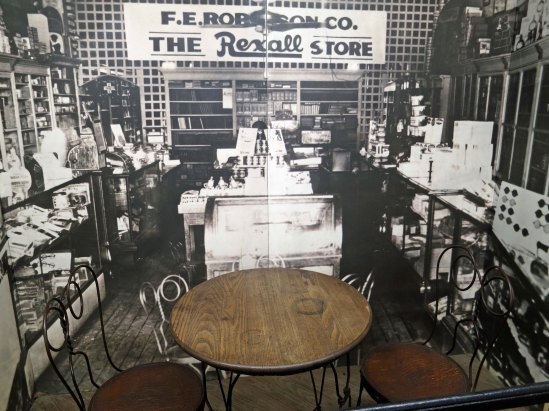 The actual table where the business leaders of Dayton plotted out the steps that would lead to the Scopes Trial. The background photograph is of Robinson's drug store where they met with John Scopes.