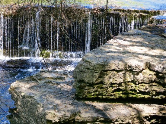 Waterfall flowing off of a limestone ledge at Old Stone State Park in Tennessee.