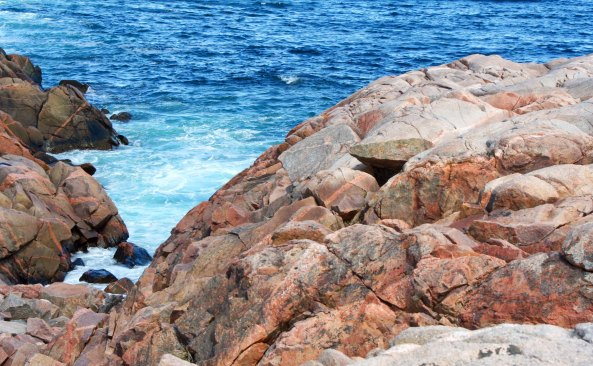 Rocky shores touched by the Atlantic Ocean are a key element in the scenic beauty of the Cape Breton Highlands along the Cabot Trail.