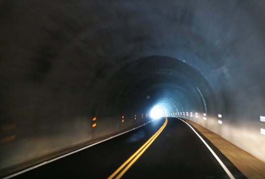 The lights from our van lit up the tunnel. Imagine your perspective from a bicycle. This was one time when I was ever so glad to see the light at the end of the tunnel.