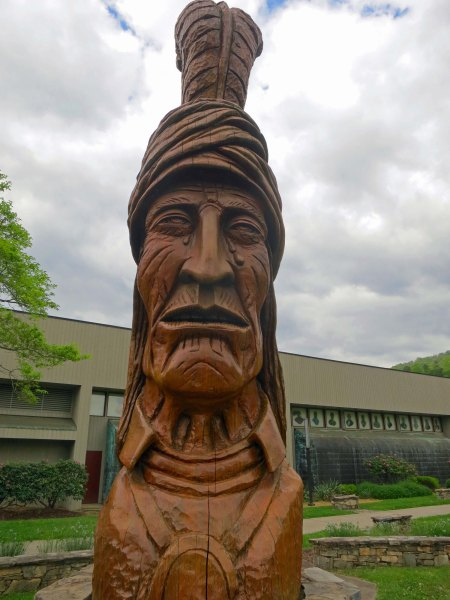 Wood sculpture of a crying Cherokee representing the Trail of Tears in Cherokee, North Carolina.