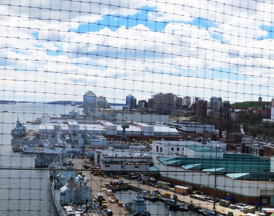 Looking back at Halifax through the screened fence on the bridge.