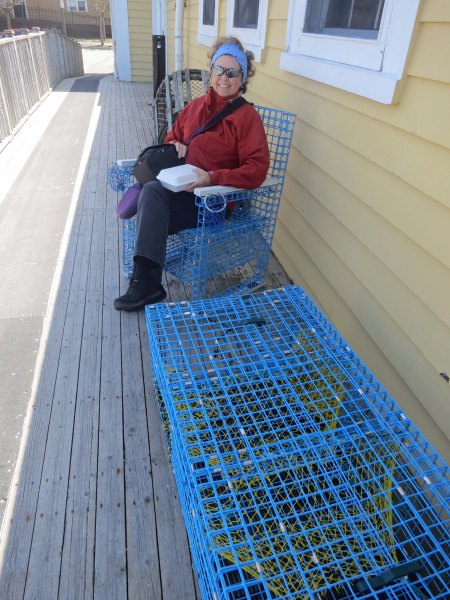 Peggy makes herself at home on furniture made out of crab traps next to a restaurant where we had dined on crab.