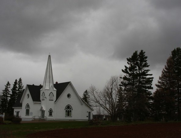 The dark, stormy skies were back the next morning. I liked the drama they created in this photo of a church.