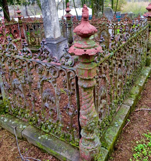 The fancier graves were surrounded by wrought iron fences like this one. We would swing on their gates, which would give off a satisfying Graveyard squeak. You can see our house beyond the fence.